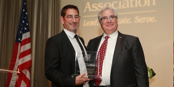 Richard Kaplan Receiving an Award from the BHBA